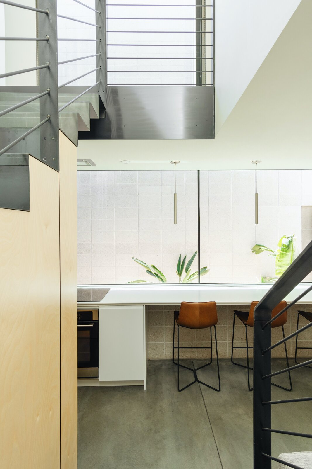 Dining area of White Stone Flats by Benjamin Hall Design.