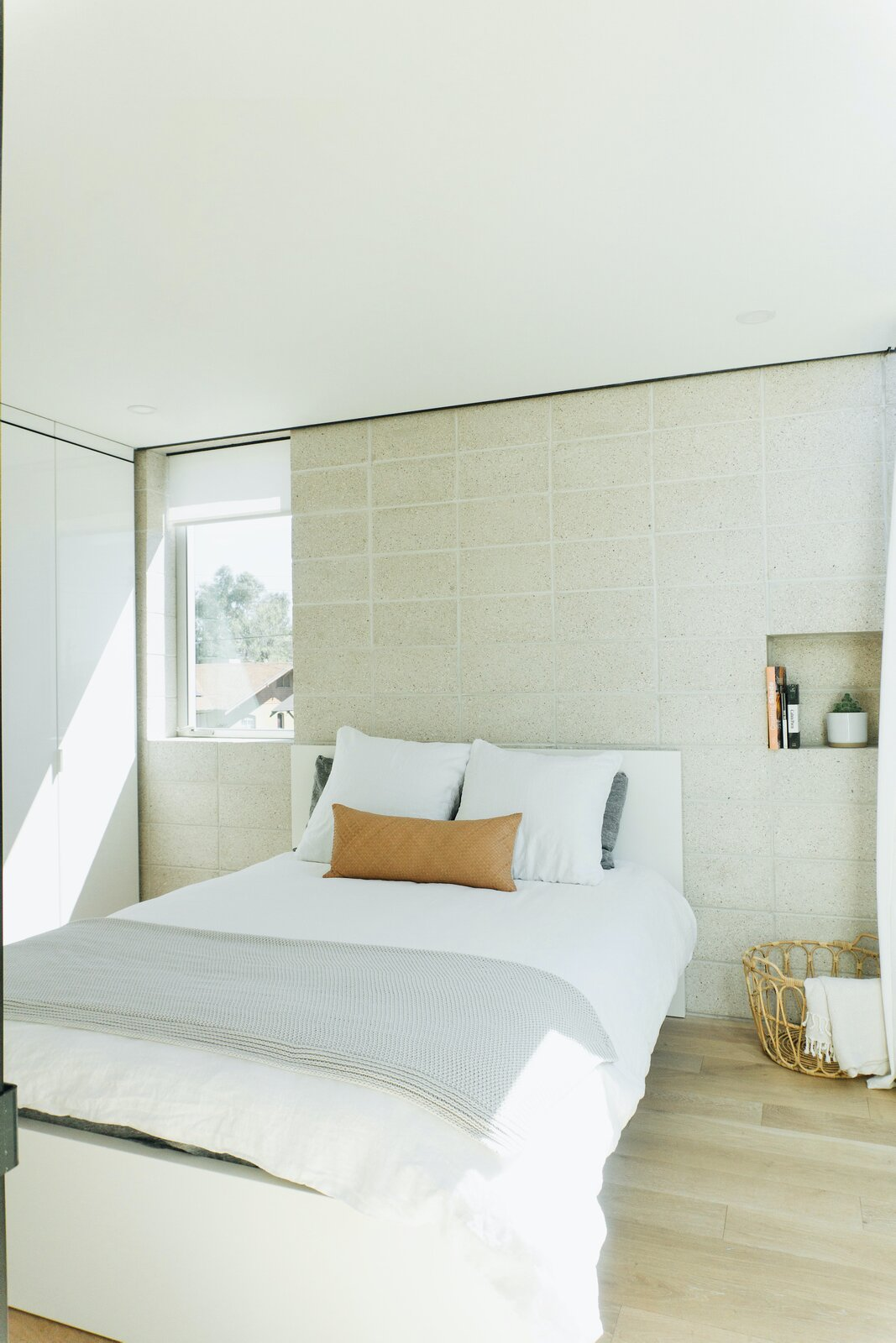 Bedroom of White Stone Flats by Benjamin Hall Design.