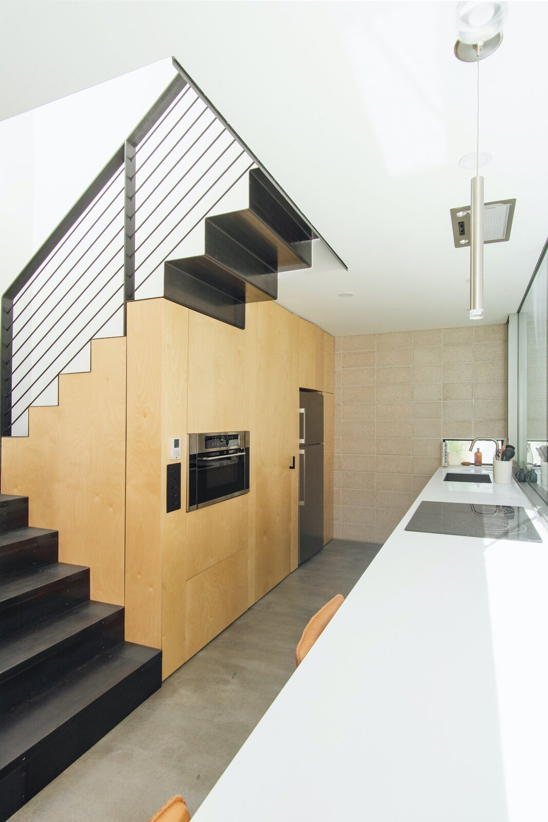 Kitchen of White Stone Flats by Benjamin Hall Design.