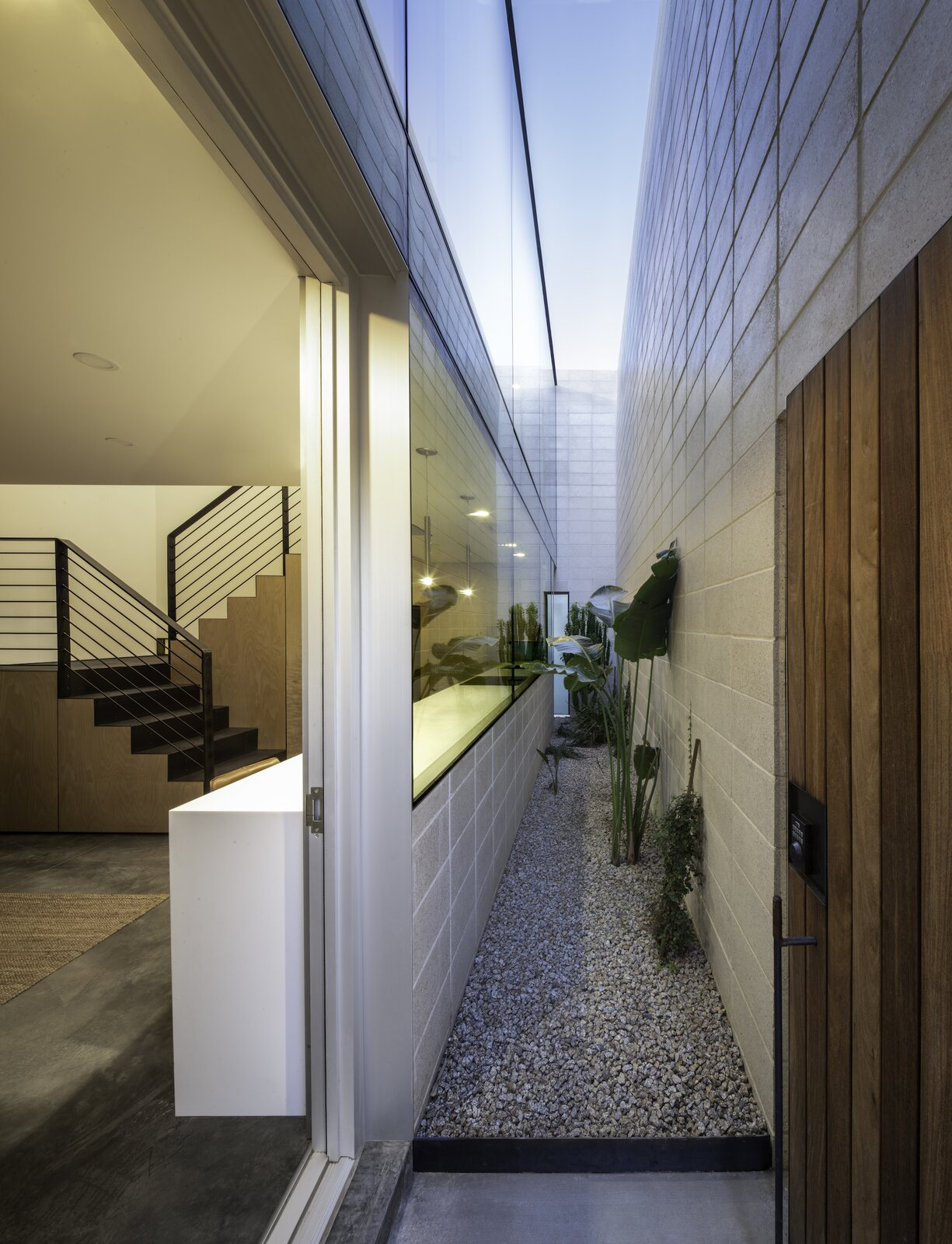 Atrium of White Stone Flats by Benjamin Hall Design.
