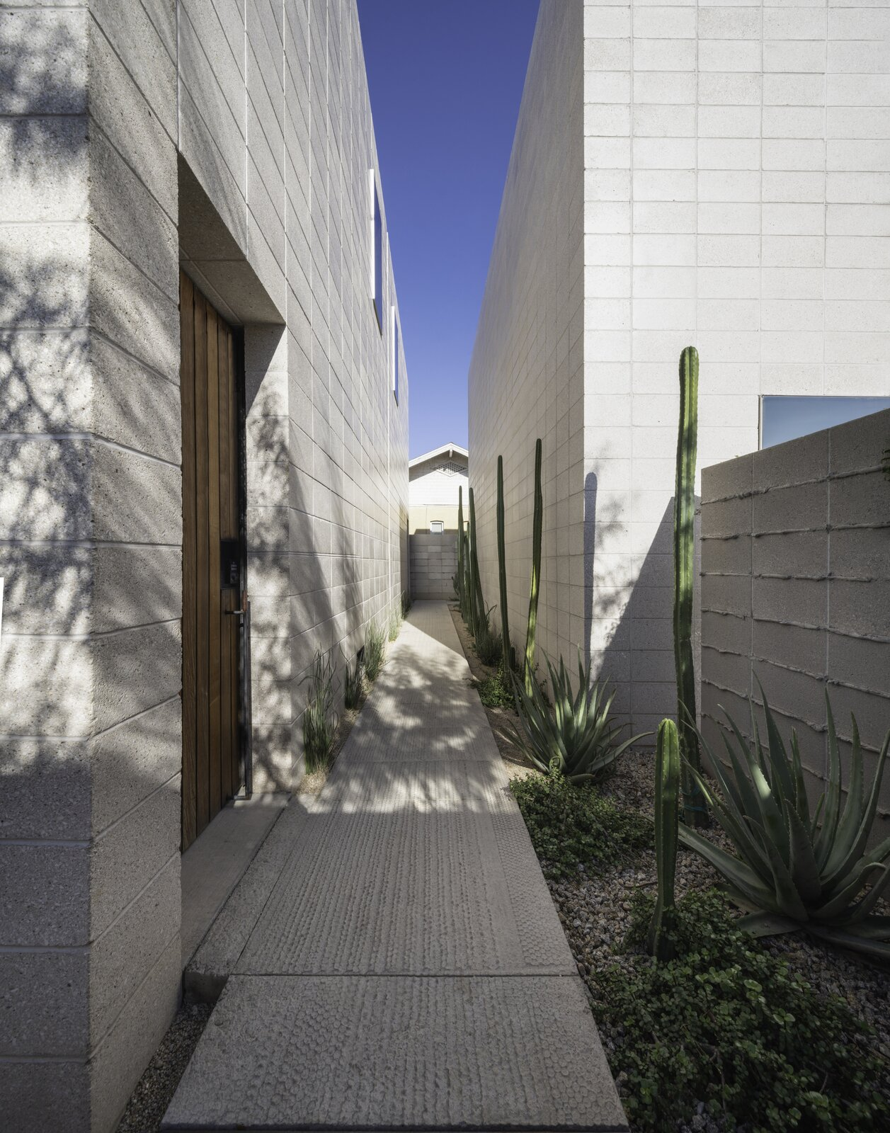 Walkway at White Stone Flats by Benjamin Hall Design.