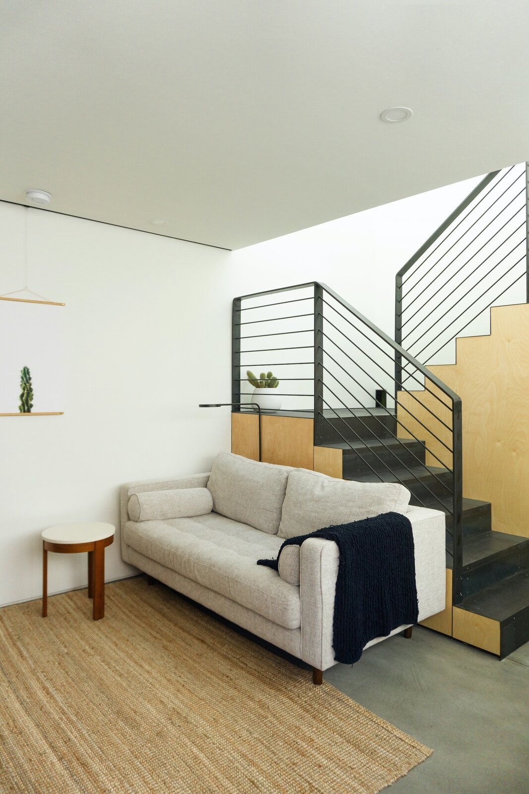 Living area of White Stone Flats by Benjamin Hall Design.