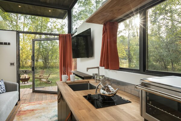 """""""By utilizing more windows, our homes bring the outdoors in, providing lots of natural light,"""" says Mackay."""