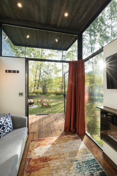 """""""The main challenge was making a space with a 250-square-foot footprint actually feel large,"""" says Mackay. """"The key to its success is high ceilings, eight-foot doors, and oversize windows."""""""