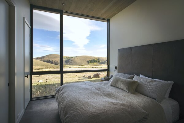 Each space in the home—including the master bedroom—features strategically placed operable windows to take advantage of cross ventilation produced from diurnal mountain winds and induce natural convection cooling.
