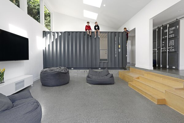 """Often the boys use the shipping containers in ways we hadn't even imagined—like bravely climbing on top of the containers and jumping onto the big bean bags below,"" says architect Paul Michael Davis. ""It's probably not advisable—a shipping container isn't a jungle gym—but it's thrilling to see a space used in ways you never expected!"""