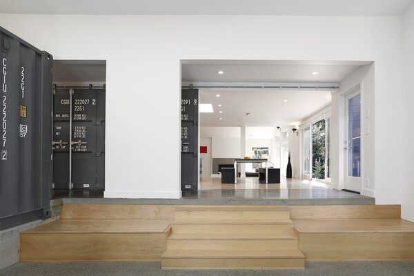 When open, the door leads into the dining room, which has been extended to create a communal gathering space for the family.