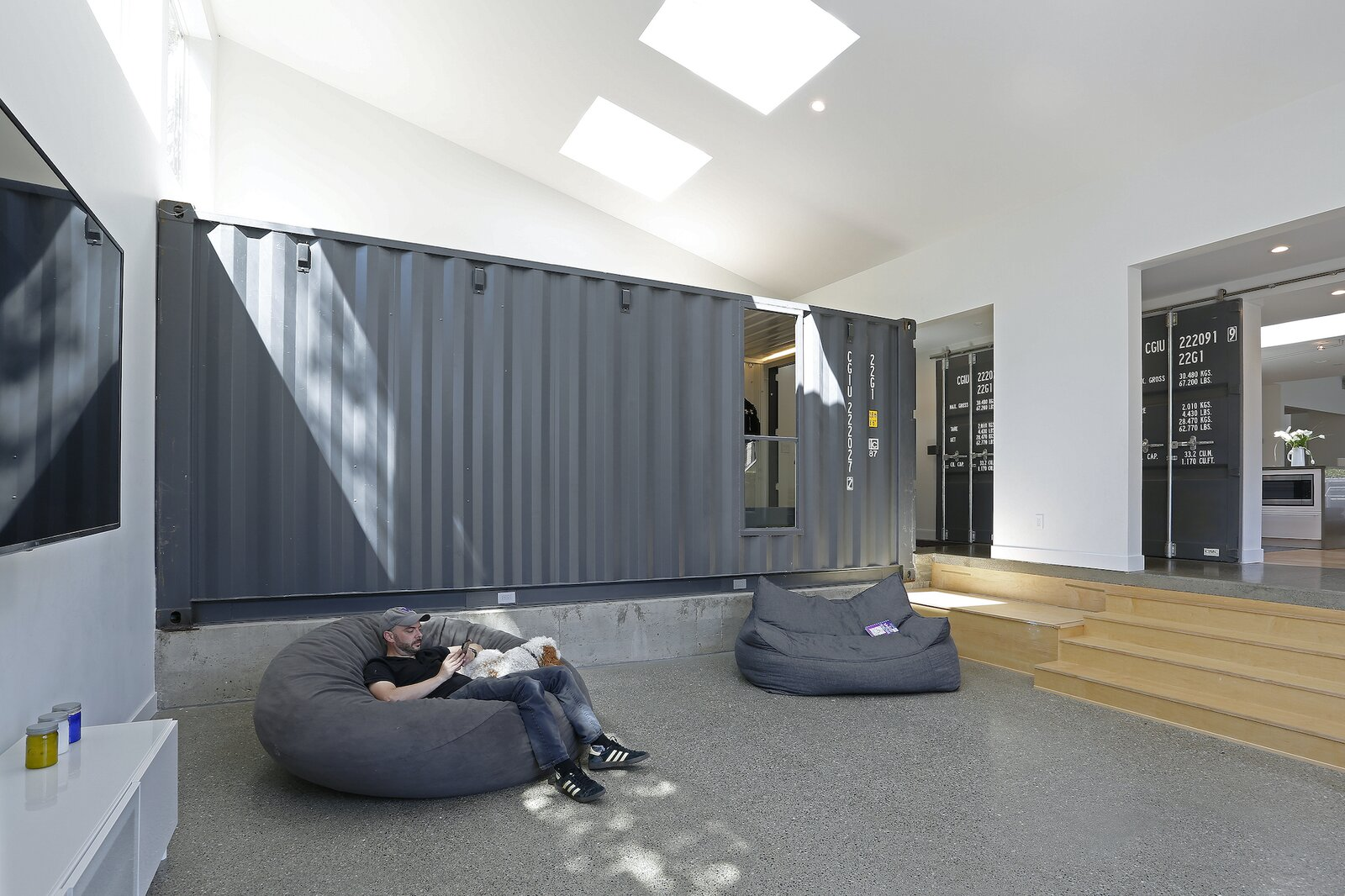 Family room of Wyss Family Container House by Paul Michael Davis Architects.