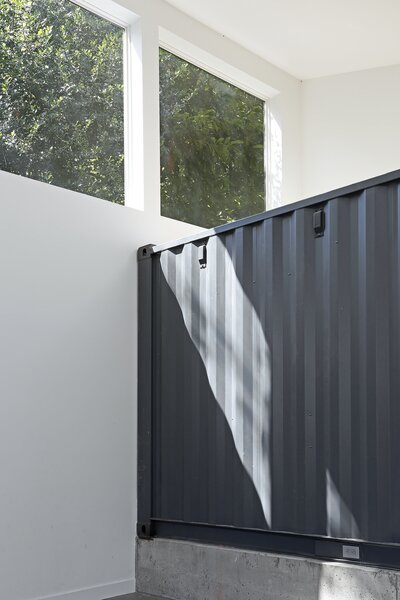 """I love the heavy weight of the dark grey container in the bright, white space,"" says the architect."