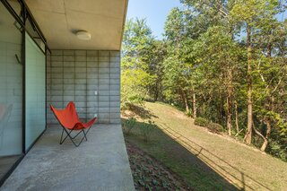 """Verandas at both the front and back of the home create spaces to engage with the landscape and for """"outside contemplation."""""""