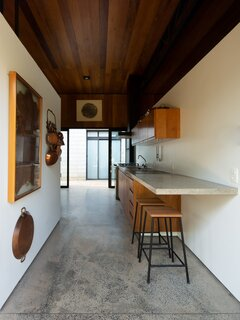 The kitchen bench extends to create a breakfast bar for casual dining.