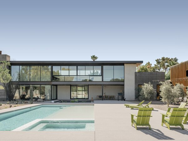 The pool and fire pit in the courtyard are at the heart of the home. The olive trees and native Ironwood trees planted around these spaces soften the rectilinear architecture.