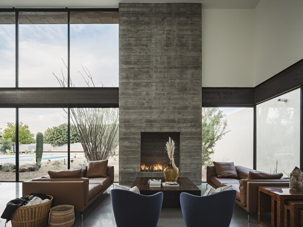 "The most costly parts of the build were the board-formed concrete walls and fireplace. ""We believe it was worth spending the money here for a few reasons,"" reveals architect Cavin Costello. ""The mass anchors the house into the landscape, and the material is incredibly durable—something we need in the harsh desert sun. The board-forms give the home a wonderful character."""