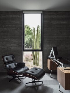 A window in the office purposefully frames a large cactus, inviting the Sonoran desert landscape into the home.