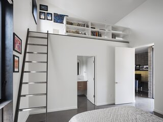 The kids' bedrooms both feature en suite baths and ladders that lead to a loft space that functions as a private living area.