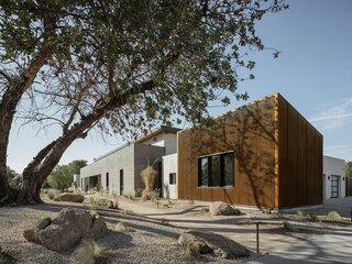 The corrugated steel siding and roof reflect the radiant heat from the desert sun.