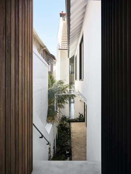 The entry off the garage has views through the home to a three-story-high window to the west that looks onto trees and the bay beyond.
