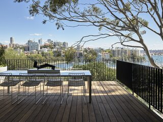 Full-height sliding doors stack back, allowing the living spaces to flow seamlessly from inside to outside. A large deck celebrates the view over Rushcutters Bay and provides an additional dining space for sunny days. A retractable awning can also be extended to protect the space from the elements.