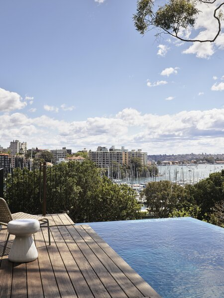 "The site has uninterrupted views over Rushcutters Bay—even from the lowest level. ""The infinity edge on the pool really makes it appear to vanish into the view,"" says architect Bronwyn Litera. ""We also love how the huge gum tree in the neighbors' property branches over the site. The main bedroom feels like it's cocooned up in the canopy, and it provides beautiful shading and dappled light over the pool and windows to the west."""