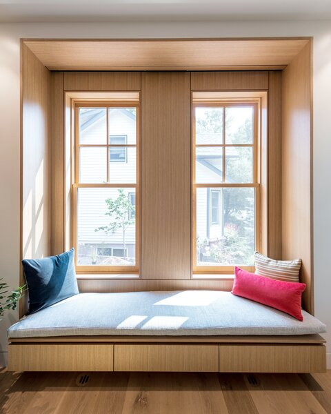 The parlor features a white oak window seat that receives eastern morning light.