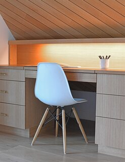 "The children's rooms both feature custom, built-in desks for studying and homework. ""There's a language of reveals and quirks and integrated pulls—handleless drawers and doors—that is consistent even if the form and function of the particular detail is different,"" says architect Nicholas Fiore."