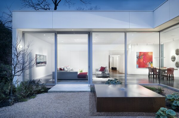 """""""The floor-to-ceiling glazing around the central courtyard is truly spectacular,"""" says architect Miguel Rivera. """"We wanted to create a sense of connection between all the spaces around the courtyard, and those large windows and sliding doors made it possible."""" The floor is at the same level as the ground outside, which creates a sense of seamless flow between interior and exterior."""