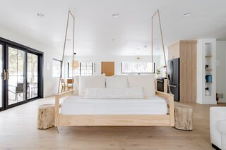 """The couch swing was the last element of The House to be designed. """"I wanted something comfortable and unique, but not weird,"""" says Tarah. """"In a stroke of genius, Drew suggested a couch swing."""" The piece was made by the couple in the garage just days before the first booking and is one of the guests' favorite features."""