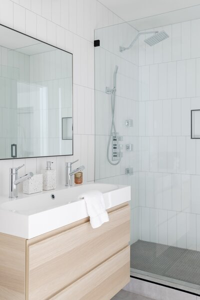 "The guest bathroom features modern fixtures, cement-look tile, and subway tile. ""This gives the space an elevated feel with high functionality, using some of the most basic materials,"" says Tarah."