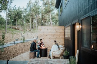 """The House features a seating area and fire pit by the main entrance. """"It's a great way to experience the peace and serenity of the outdoors,"""" says Tarah."""