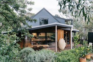 "The renovation introduced a new deck, and opened up the living and kitchen areas. ""The home is 'so Warrandyte,'"" says builder Hamish White. ""It has a great connection with the outdoors, views of trees from most windows, and a homely and familiar feel which makes it really comfortable to be in."""