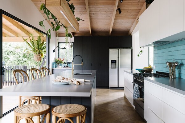 "From the central kitchen island, there is a continuous line of sight to the garden. ""Milli loves her indoor plants,"" says builder Hamish White. ""The tree views from most windows, and all the indoor plants makes you feel as if nature is never far away."""