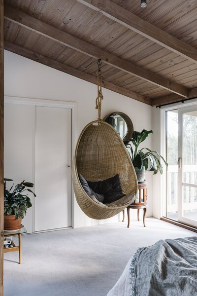 The master bedroom has a hanging egg chair identical to the one on the deck.