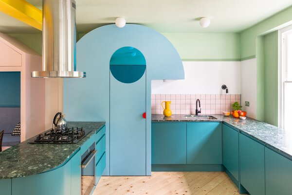 "The curved blue kitchen larder has a projecting ""nose"" that illuminates the worktop and a mirrored eye that ""winks"" each time the door is opened."