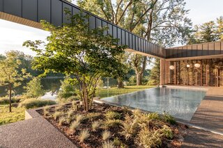 The pool was purposefully constructed close to the indoor living spaces in order to contribute to the interior ambiance. The material palette was informed by the color of the surrounding trees—clay brick for the walls, wood for the soffits, and stone for the flooring.