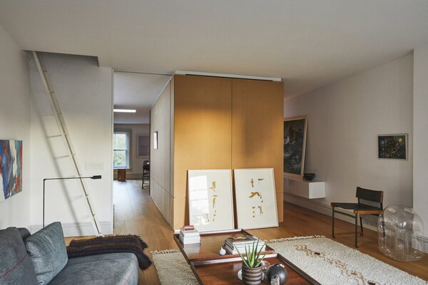 The third floor features a bespoke timber joinery unit that divides the dining and living spaces and contains a bathroom and storage.