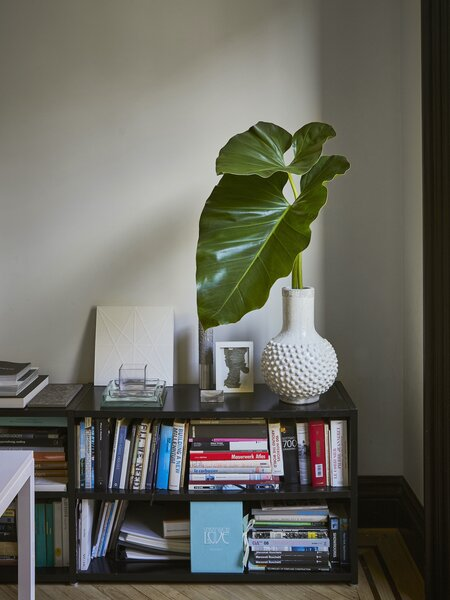 A low shelf in the Uli Wagner Design Lab office houses the studio library as well as an assortment of objets d'art that give the space a unique character.
