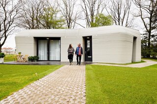 Dutch couple Elize Lutz, 70, and Harrie Dekkers, 67, are the tenants of the 3D-printed home near Eindhoven's Beatrix canal. They picked up their digital access key on April 30, and they will officially move in on August 1. The retired shopkeepers from Amsterdam applied to live in the property for six months following a call for applicants, and they are paying €800 a month—about half the market value.