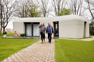 A Dutch Couple Are the First Tenants of This Boulder-Shaped 3D-Printed Home