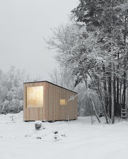 A Tiny Timber Cabin Takes Root in a Russian Forest for $13.4K