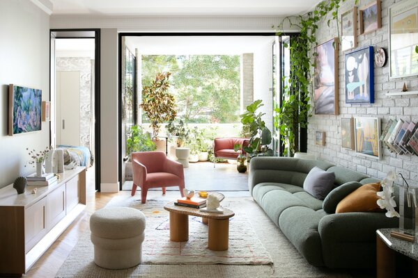 The couple's home features a living space that opens out to a terrace overlooking a leafy street in Waterloo. It's filled with a carefully curated collection of furniture, objects, and artwork by local brands and designers that celebrate Australian creativity.