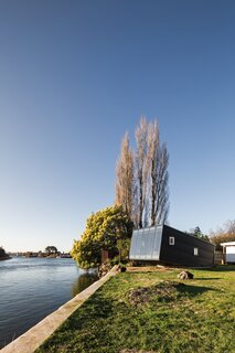A Tiny, Prefab Cabin Soaks Up Riverside Views in Chile