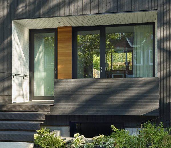 The perennial front porch, re-imagined as a seamless extension of the home's interior.
