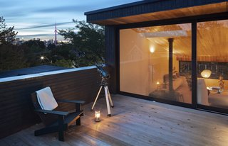 An upper level outdoor terrace offers easy enjoyment of the city skyline, urban tree canopy, sunsets, and the night sky.