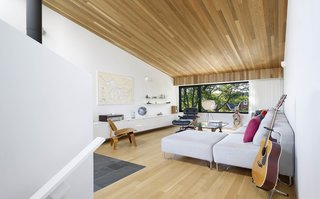 The sloped living room ceiling creates an intimate compression at the low end - a delightful spot to read within the tree tops, or enjoy snow falling on the street below.