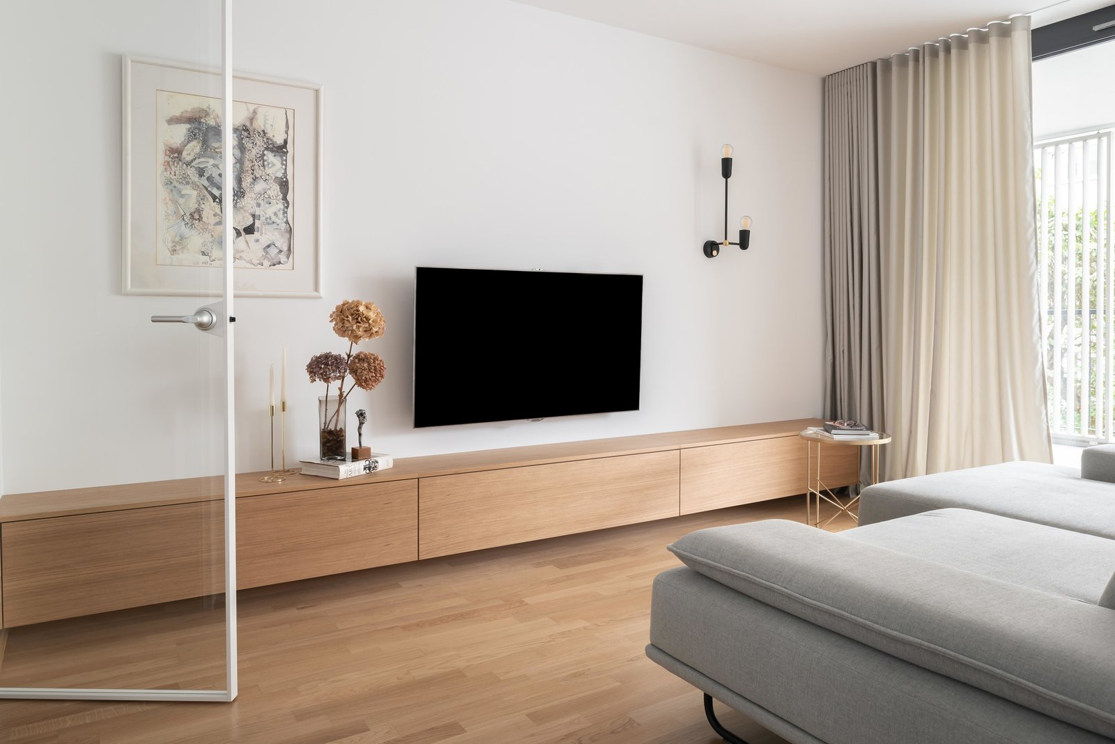 Living Room, Sofa, Coffee Tables, Media Cabinet, and Wall Lighting Living room  Lady by idealist studio