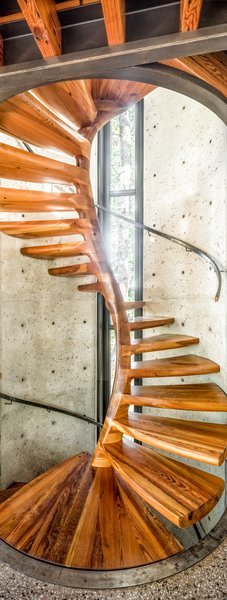 The home's centerpiece spiral staircase connects all three levels. Designed by Tom on Solidworks, the blanks were cut in a friend's woodshed and later assembled on-site.