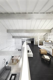 The exposed beams lend an industrial character to the home while emphasizing the linearity of the plan.
