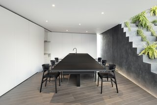 The custom-built dining table can flip up to accommodate additional seating.