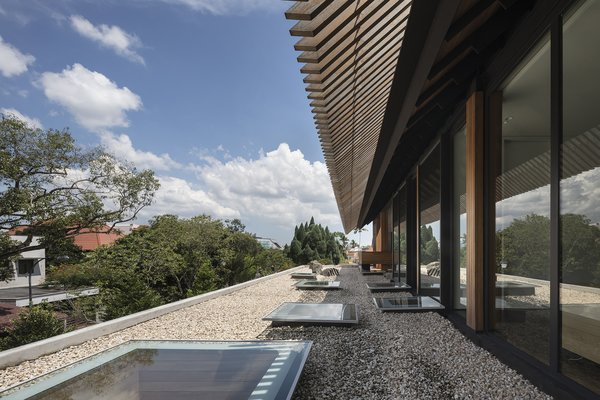 The rock garden on the first-story roof canopy offers contemplative views to rooms on this side of the house.