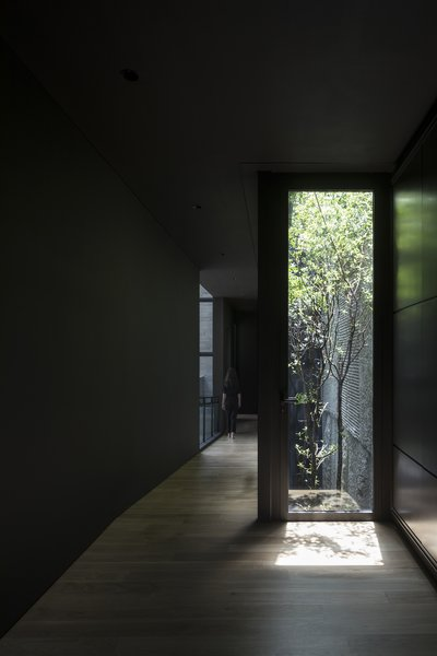 A courtyard rises up through three stories of the house.